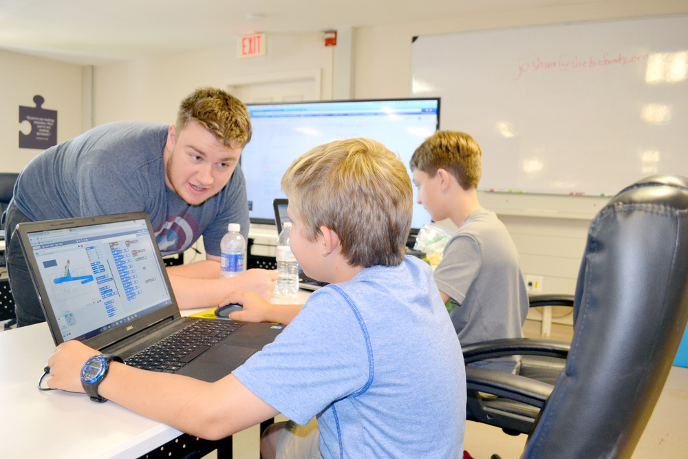 Tennessee Code Camp instructor Joshua Vaden talks coding strategy with Nicholas Canfield, left, and Landon Bowling, both of Cookeville. The camp was held July 11-15 at the Biz Foundry in Cookeville.