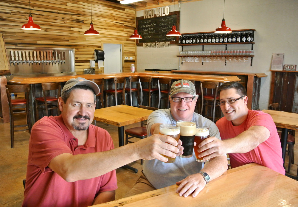 Red Silo Brewing Company chief operating officer Jim Helton, chief executive officer Mark VanderBleek and chief marketing officer Elijah Thomen enjoy their creations.