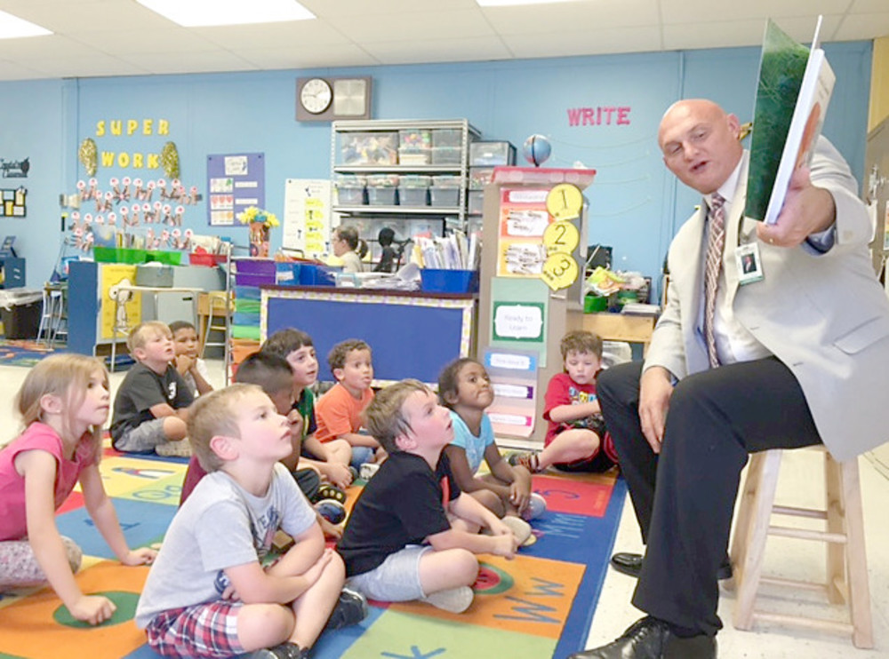 Director of Schools Jerry Boyd reads to kindergartners in Crystal Amirhanian's class at Northeast Elementary School. National Read With a Child Week is Sept. 18-24.