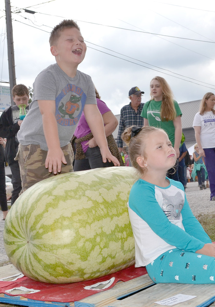 Layne and Sophia Ault of Jamestown check out the 290-pound watermelon, which was grown by Chris Kent of Sevierville, during Saturday's Great Pumpkin Festival in Allardt.