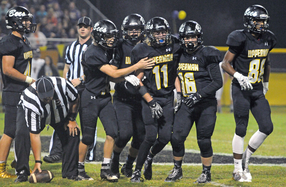 Upperman High School's Brett Burish (11) is congratulated by several ...