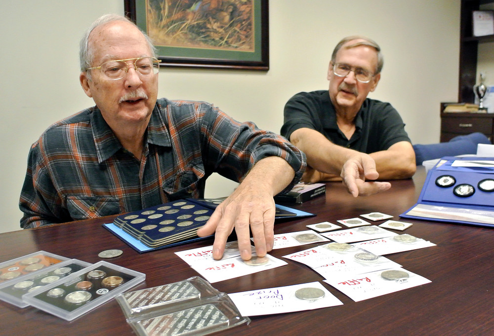 Rich White, left, and Dennis Wittenberg, president of the Upper Cumberland Coin Club, talk about some of the items in their collections while preparing for the next club meeting.