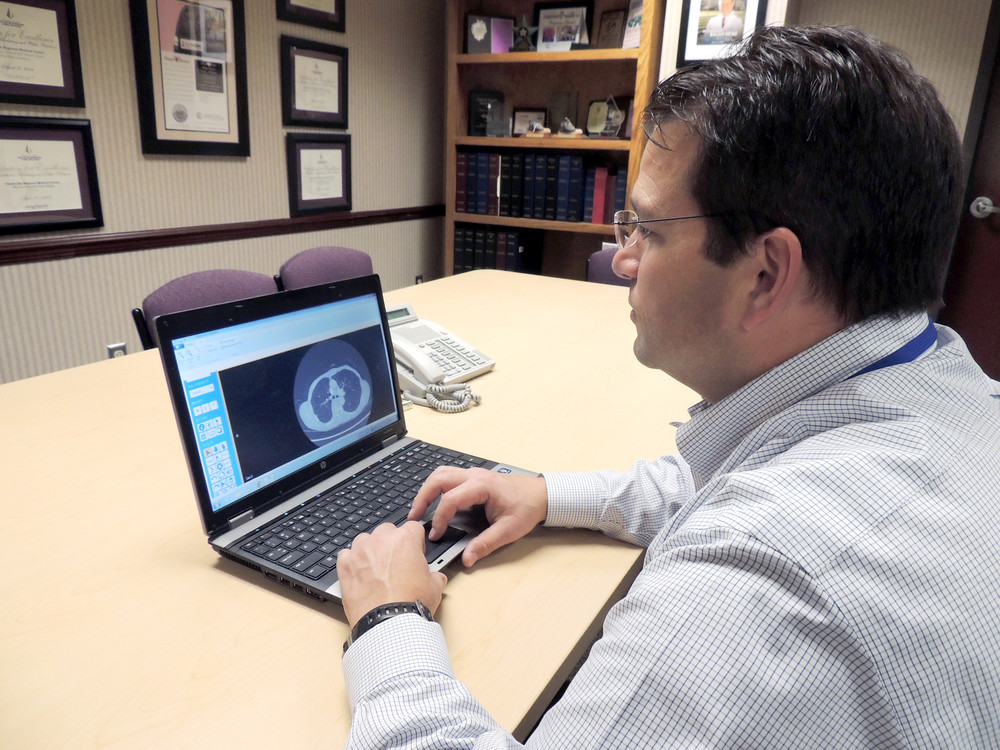 Ali Bagci, CRMC's imaging information systems administrator, looks at the RadConnect system.