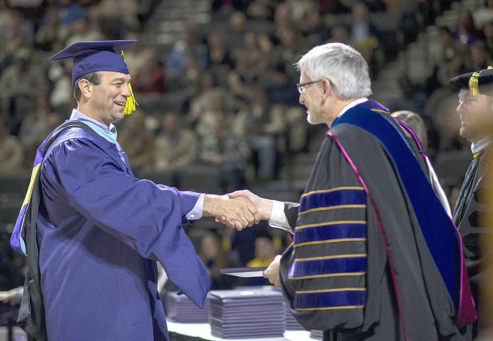 Lt. Les Dolente, the director of Tennessee's Executive Protection Unit that protects Gov. Bill Haslam, is congratulated by Tennessee Tech President Phil Oldham during commencement ceremonies on Saturday at Tech.