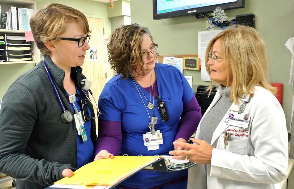 Dr. Jacqueline Ansell, right, CRMC neurohospitalist, looks over the stroke protocol with nurses, from left, Emily Hunt and Kelsey McCulley.