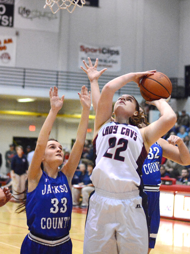 Cookeville's Chloe Grace Savage, right, puts up a shot in the paint against Jackson County's Alexis Ragland, left, during the Lady Cavs' 41-21 win over the Lady Blue Devils on Friday night at CHS.