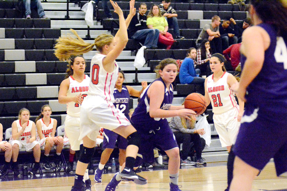 Burks' Ashlee Clarks splits the defense during action Monday night in Monterey.