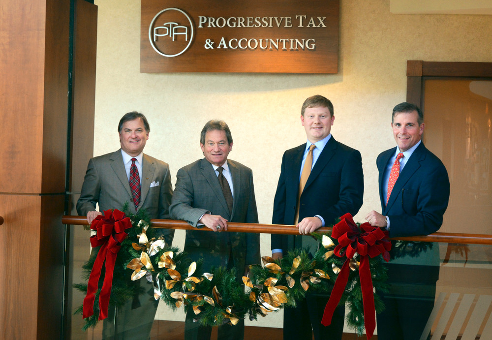 Celebrating the establishment of Progressive Tax and Accounting, from left, are Steve Rains, CEO of Progressive Financial; Sam Sandlin, CPA; Tyler Atkinson, tax attorney; and Wayne Cravens, president of Cravens & Co.