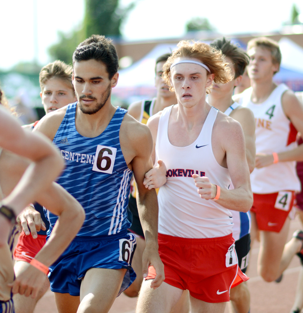 In this photo from May 2016, Cookeville's Conner Hawkins, right, tries to gain position on a Centennial runner during the Class AAA 1,600-meter state championship race at Middle Tennessee State University in Murfreesboro.