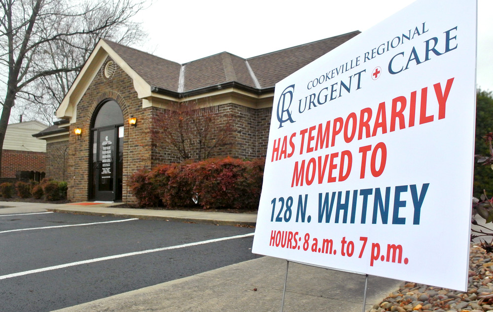 A sign announces the temporary relocation of Cookeville Regional Medical Center's Urgent Care clinic.