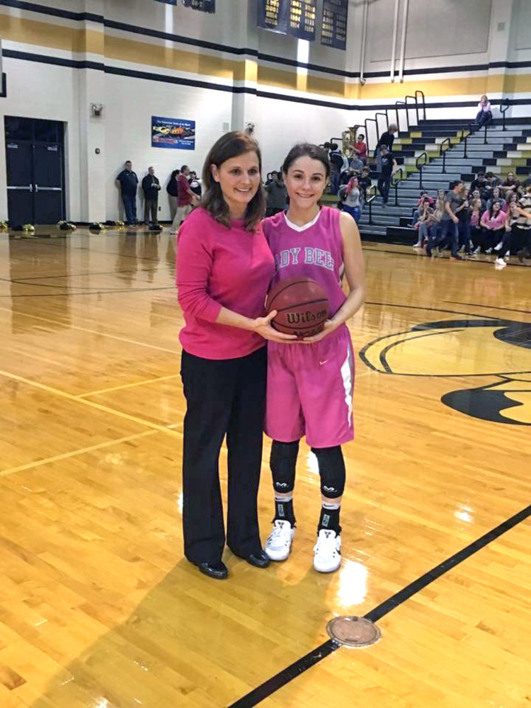 Upperman High School's Gracie Maynord, right, was presented with a ...