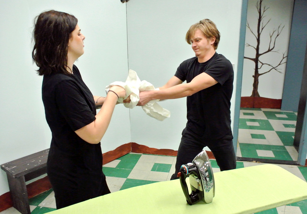 Mae (Rachel Mayes) and Lloyd (Christian Bare) fight over the laundry.
