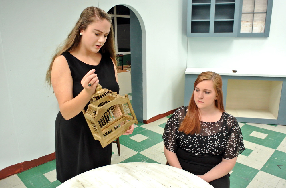 Mrs. Peters (Brenna Edgemon) and Mrs. Hale (Angie Creasy) discuss some of the unusual clues they found. .