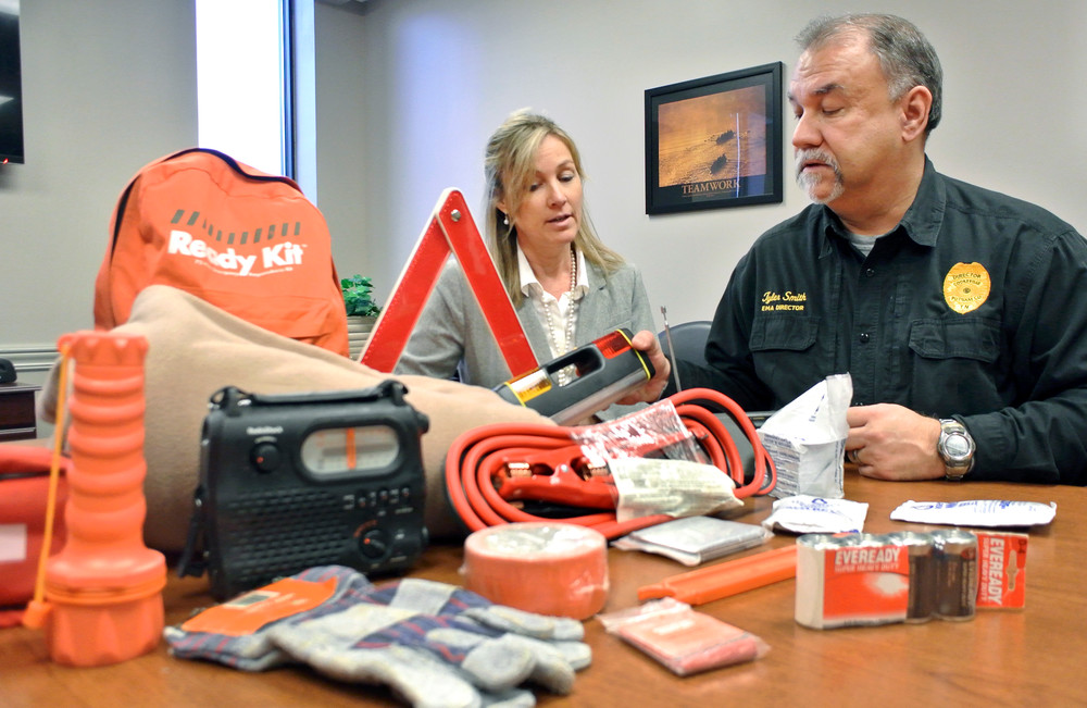 Lisa Bumbalough, director of the Putnam County Health Department, and Tyler Smith, director of Putnam County Emergency Management Agency, put together cold weather emergency kit to place in cars.