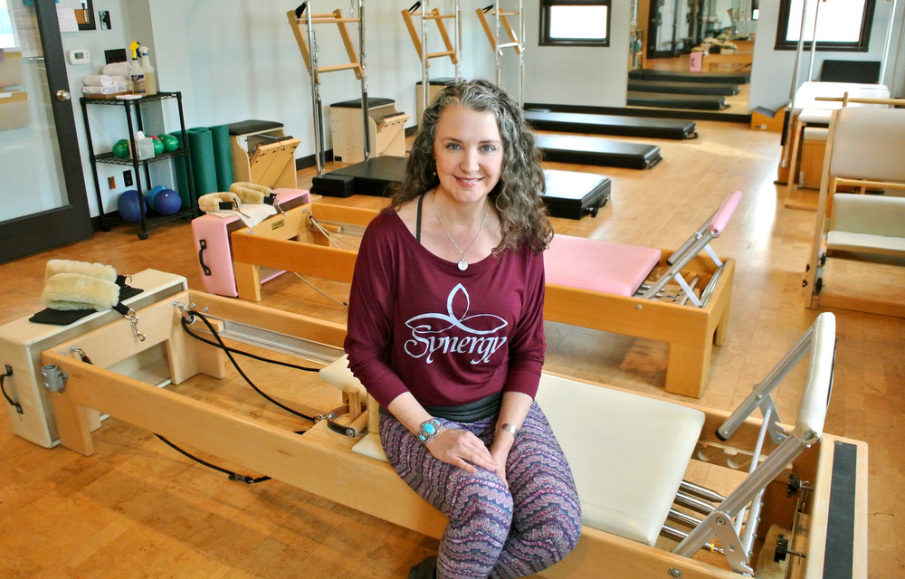 Petti Groth, owner of Synergy Mind and Body studio, in the Pilates portion of her studio on Broad Street.
