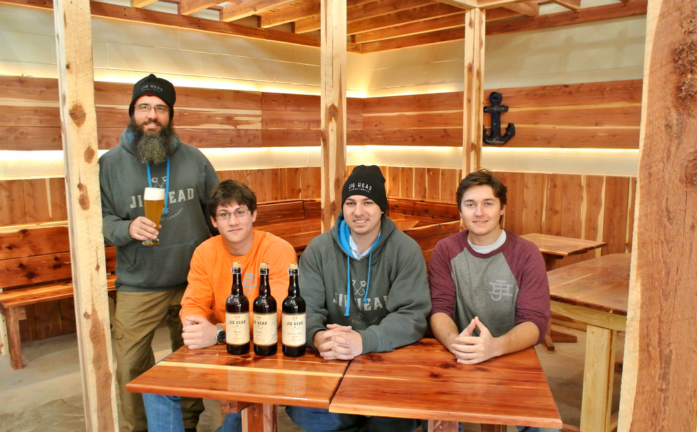 Jig Head Brewing Company is slowly taking shape. Showing off some of the gear in the new space, from left, are Manny Edwards and his sons, Ben, Jake and Nick.