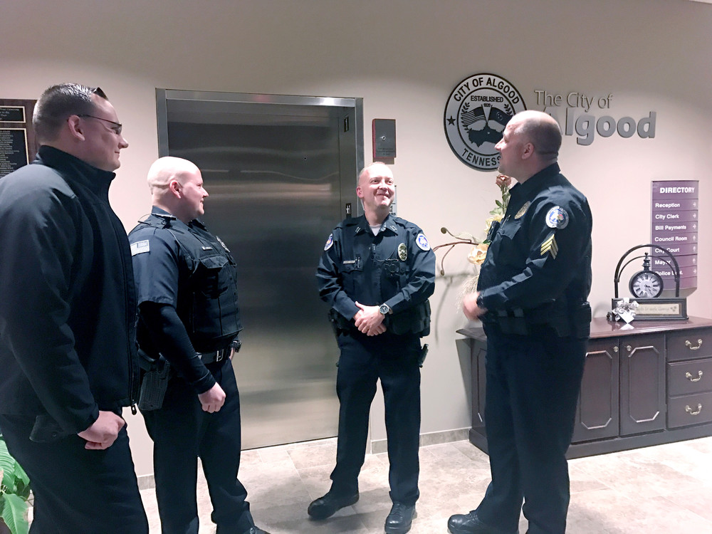 From left, Algood Police Sgts. Chris Ferguson and Andy Julian enjoy a laugh with interim chief Bryant Swallows and Sgt. Roy Phipps.