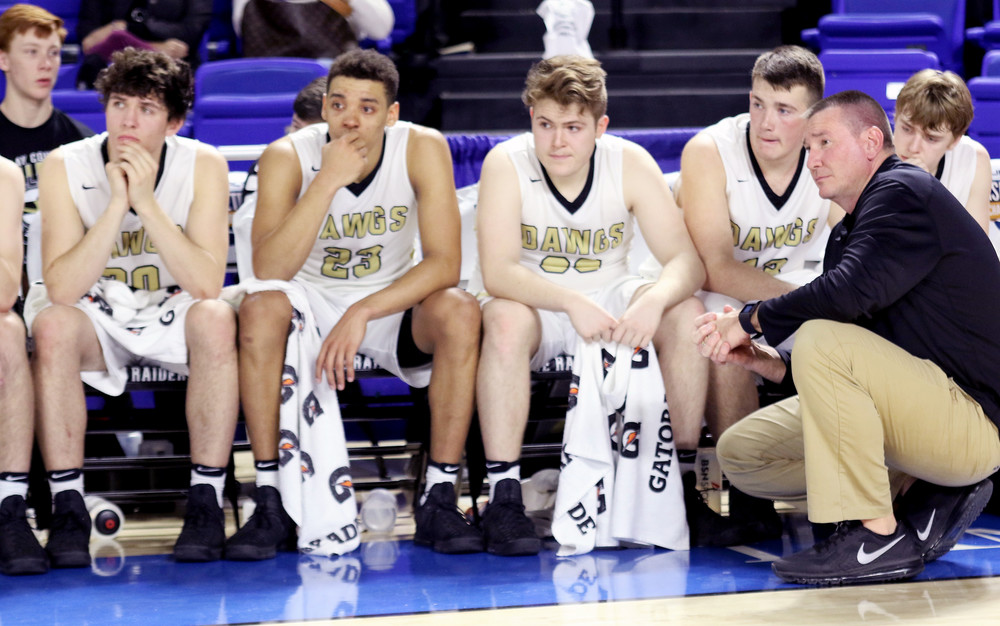 Clay County coach Rob Edwards stays with his team after the Bulldogs fell 74-73 in the title game of the boys' state basketball championship Saturday in Murfreesboro.