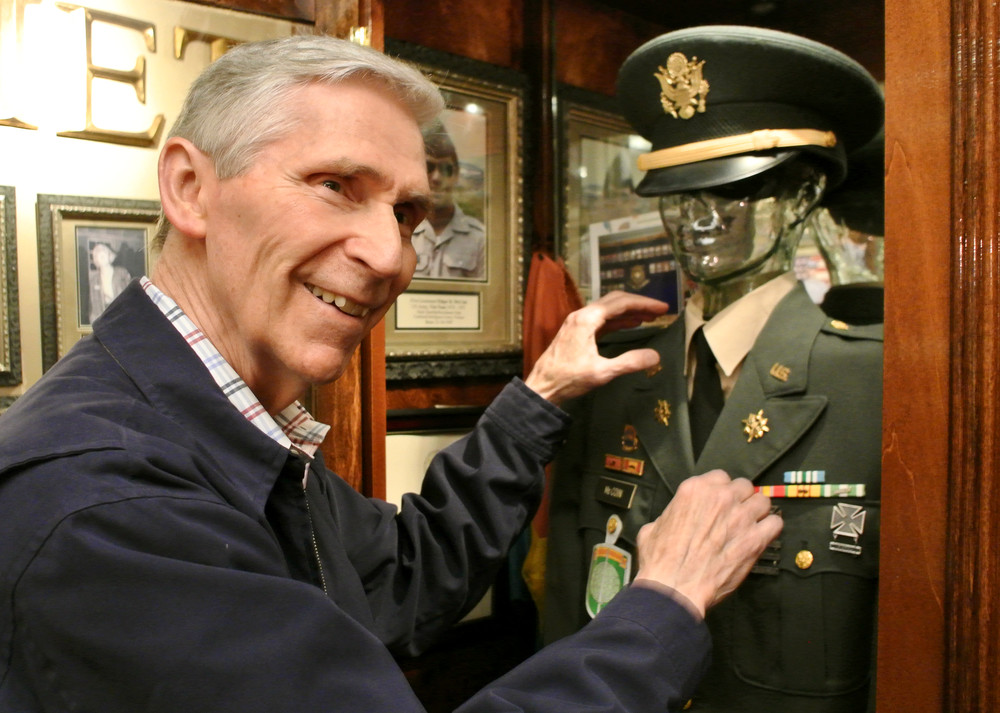 Ed McCain adjusts his old Army uniform on display at the Putnam County Veterans Hall.