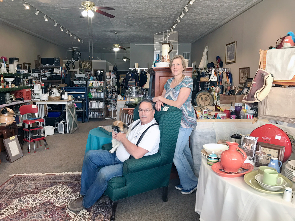 "Claude Remsing, seated with ""Dolly,"" and Camille Fliss-Mayberry are pictured among some of the items for sale at Unique Treasure Chest."