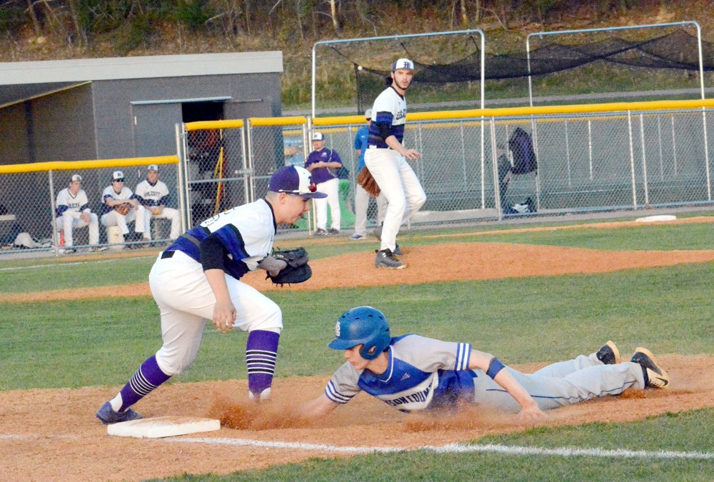 Monterey's Parker Stout tries to tag Jackson County's Connor Brown during action Monday night in Monterey. The Blue Devils scored two runs late to beat the Wildcats, 5-3.