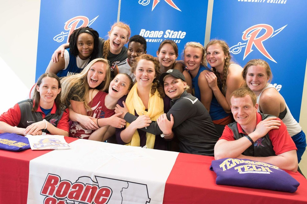 Roane State Community College center Lacy Cantrell (with scarf) celebrates with her team after signing a national letter of intent Friday to play basketball at Tennessee Tech University. Cantrell averaged 13.5 points per game last year to help RSCC finish 16-15 in one of the strongest regions in the country.