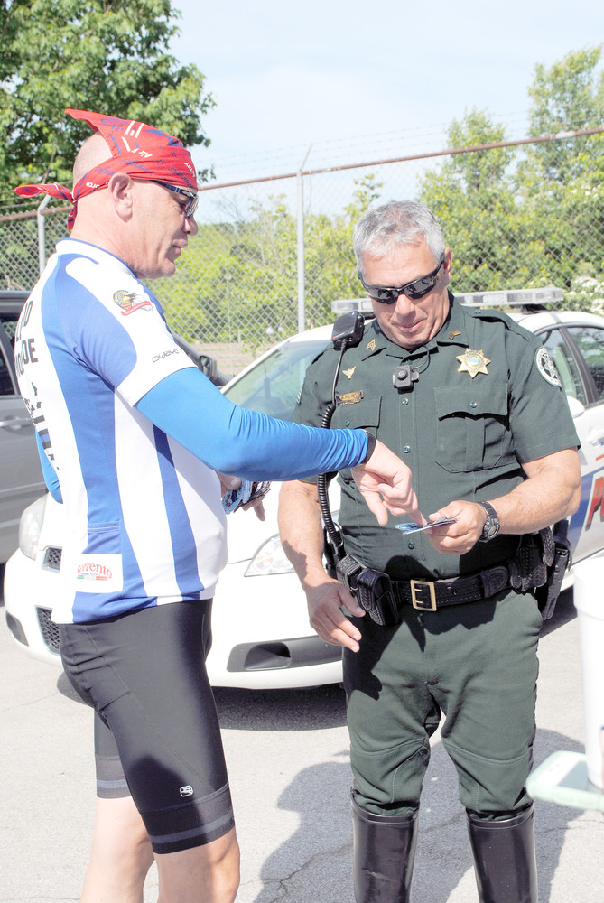 LAPD retired Officer Vinny Stroway exchanges patches with Putnam County Sheriff's Deputy Al Reyes while the Hollywood Memorial Ride, a cross-country bike ride to Washington, D.C., stopped in Cookeville Monday afternoon.