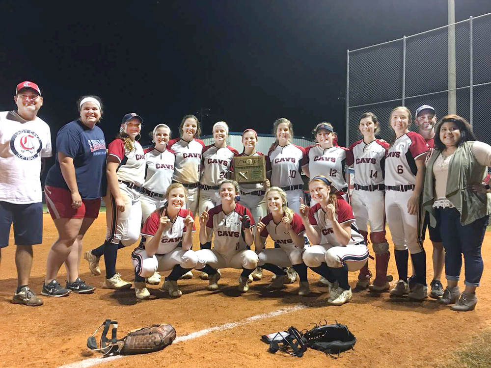 The Cookeville High School Lady Cavaliers celebrate their district softball championship Thursday night after knocking off Warren County in the final game.