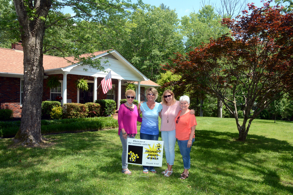 Tonya Cummings' property at 207 1st Ave. N. in Baxter is the recipient of the Baxter Beautification Committee's Property Award for the month of May. From left are Jeanie Lee, beautification committee member; Tonya Cummings, property owner; and beautification committee members Kim Phann and Sharon Watts.