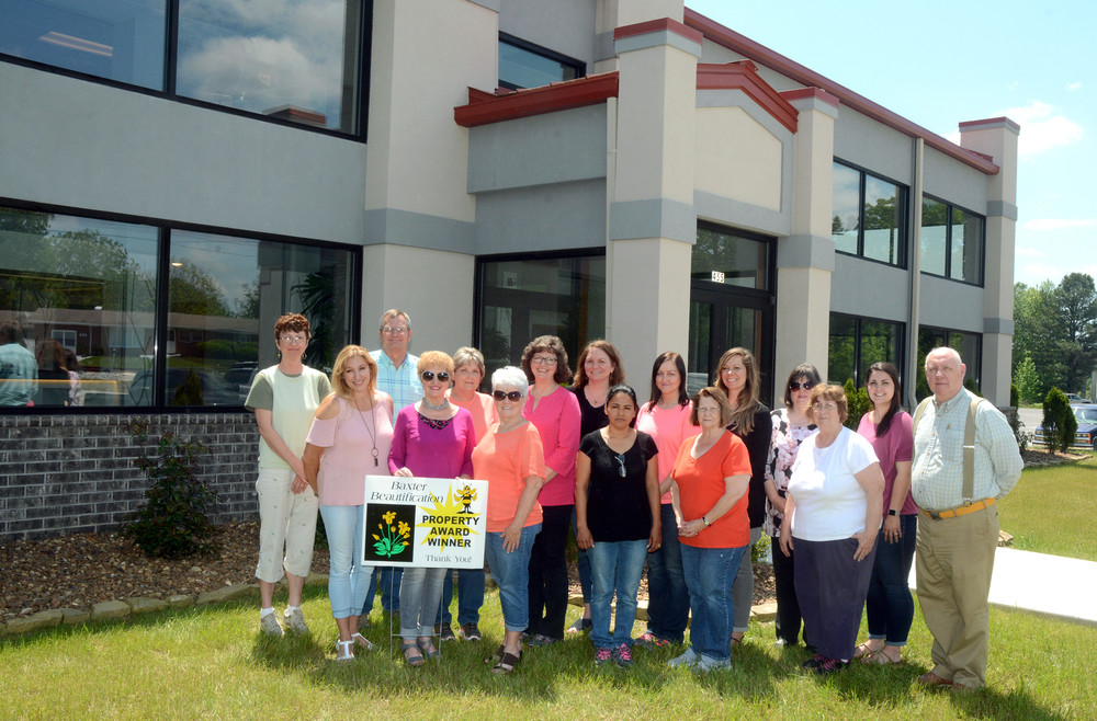 Fixtur World was recently honored by the Baxter Beautification Committee for the month of May. In front, from left, are beautification committee members Kim Phann, Jeanie Lee and Sharon Watts and Fixtur World employees Ana Vela, Freda Hager, Barbara Loftis and Bil Rummel; and in back, employees Rhonda Pennington, Mark Stebing, Wanda Harris, Loretta Bullock, Marcie Ferran, Sherry Smith, Nichole Hosse, Vicki Williamson and Ashley Carter.