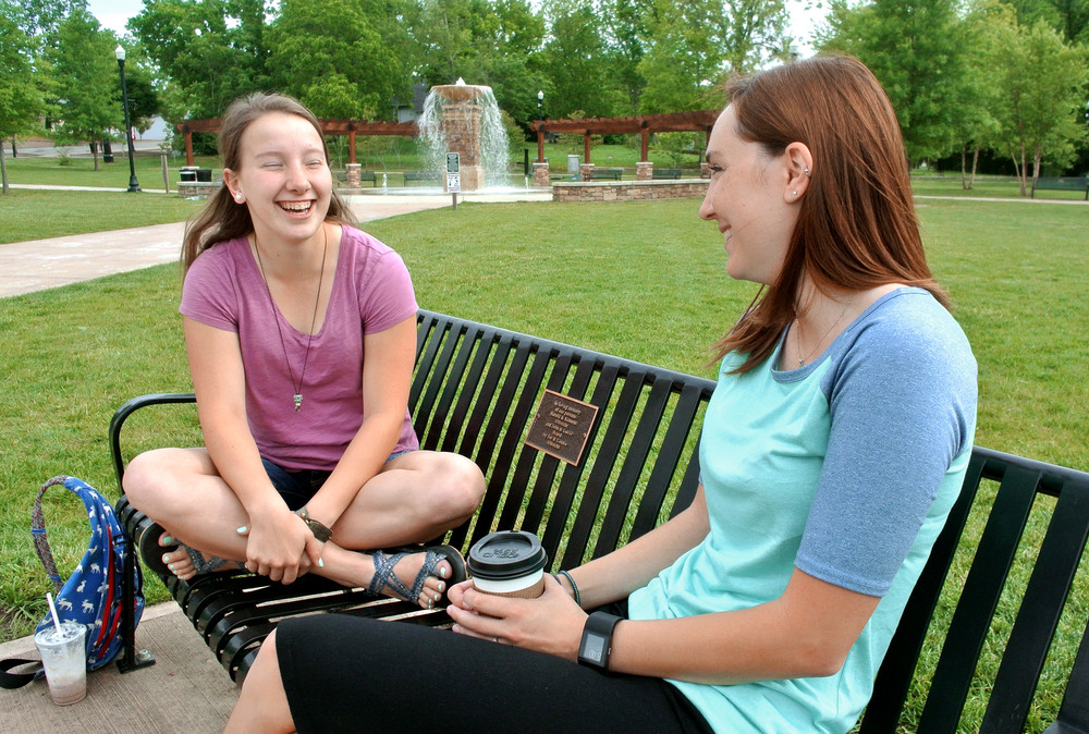 Olivia Crossman, left, and Lana Garrett take a breather in Cookeville's Dogwood Park to sip coffee and chat. The park is an increasingly popular gathering spot, particularly with warmer weather settling in.