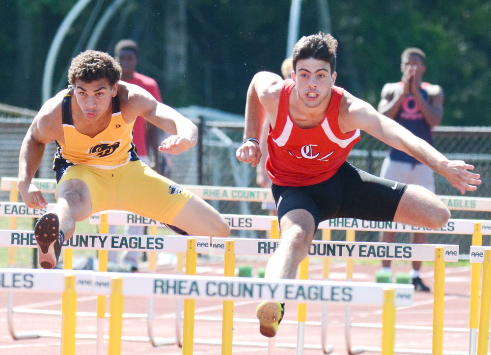 Cookeville's Patrick Gagos, right, strides over the hurdle during the Class AAA Sectional Track Meet Tuesday at Rhea County High School in Evensville.