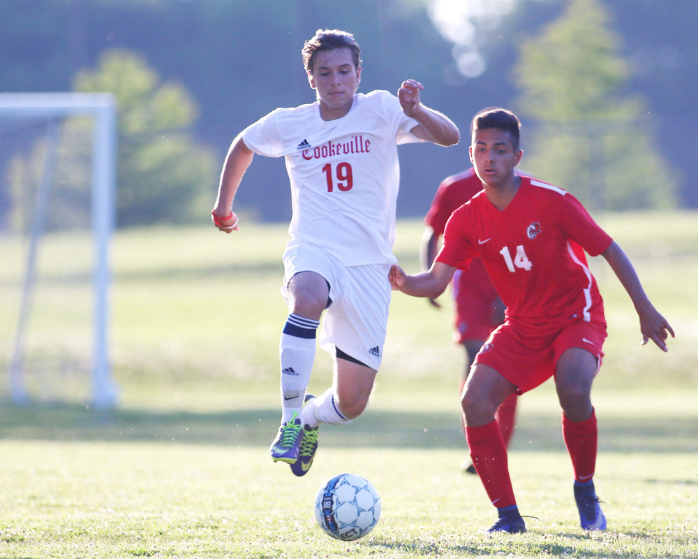 Danilo Martins, left, takes the ball away from Ooltewah's Christian Angulo during action Tuesday night.