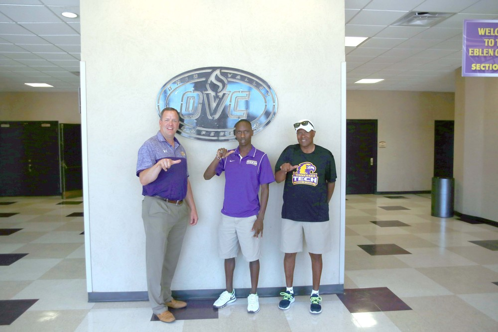 Tennessee Tech's Gilbert Boit, center, shows off his new OVC Championship ring with coach Wayne Angel, right, and Athletic Director Mark Wilson.