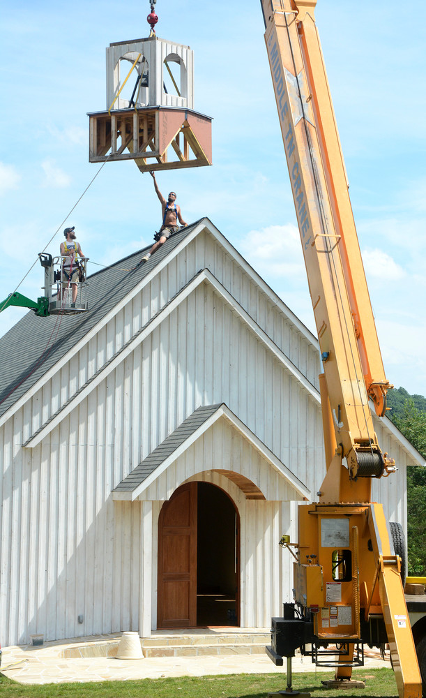 Holloway & Sons Construction Co. raised the steeple Wednesday on the chapel at Lane's Bend on Hwy. 70E. Lane's Bend is a new wedding and event venue. From left are Max Greenwood and Jason Holloway.