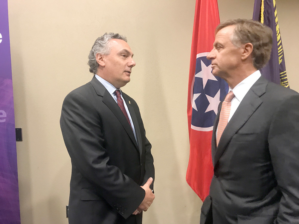 SAIC CEO Tony Moraco and Tennessee Gov. Bill Haslam enjoy a one-on-one following an event Monday afternoon welcoming SAIC to Cookeville.