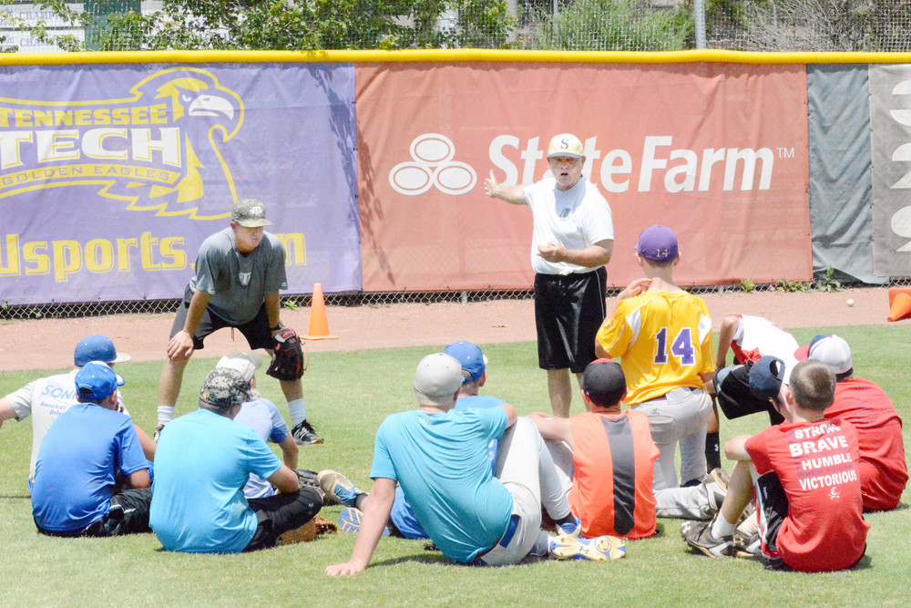 About 100 area youth recently spent three days on the Tennessee Tech campus participating in the 2017 Golden Eagle Baseball School. Eddie Cisson (above in white shirt), a high school coach in South Carolina, speaks to a group of campers during an outfield mechanics session.