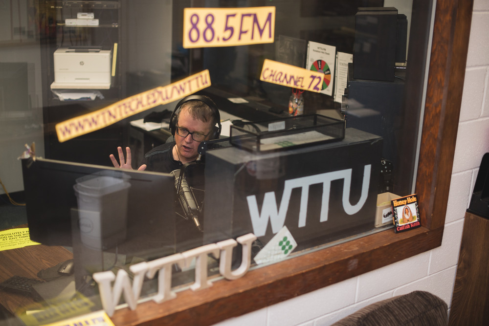 Andrew Smith, English instructor at Tennessee Tech, is in the WTTU FM radio studio on Monday evenings airing his show Teacher on the Radio. Teacher on the Radio's 300th episode will air Monday, June 19.