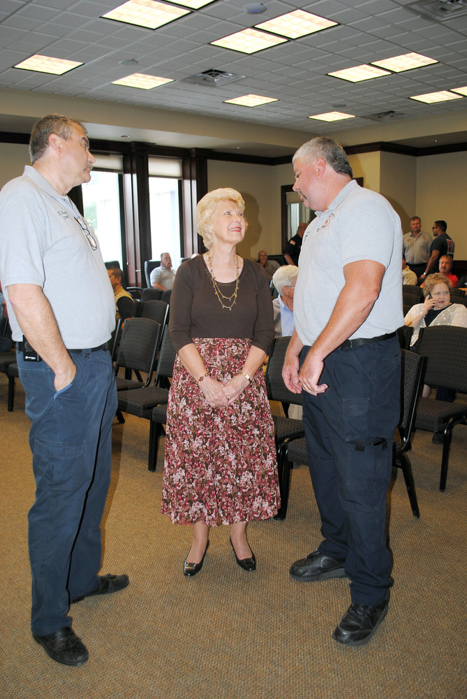 Retiring Cookeville Fire Chief Roger Fuqua, left, talks with his aunt, Linda Hughes, and new chief Daryl Blair during a reception to honor Fuqua's service to the city fire department on Friday.