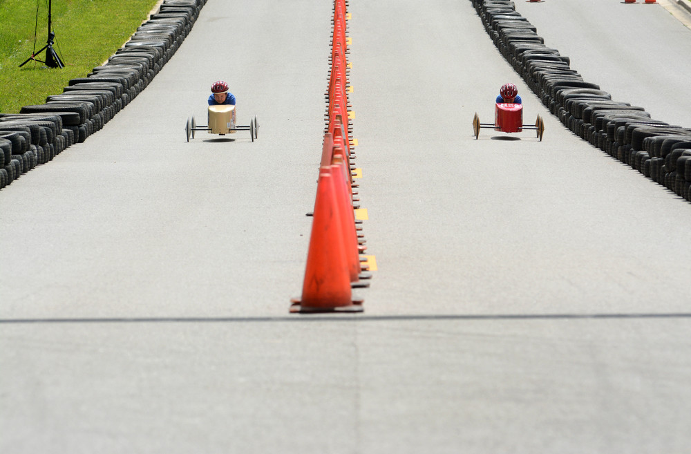 Caleb Dill and Anessa Loftin race down the 800-foot track during Cookeville's Soap Box Derby on Saturday.