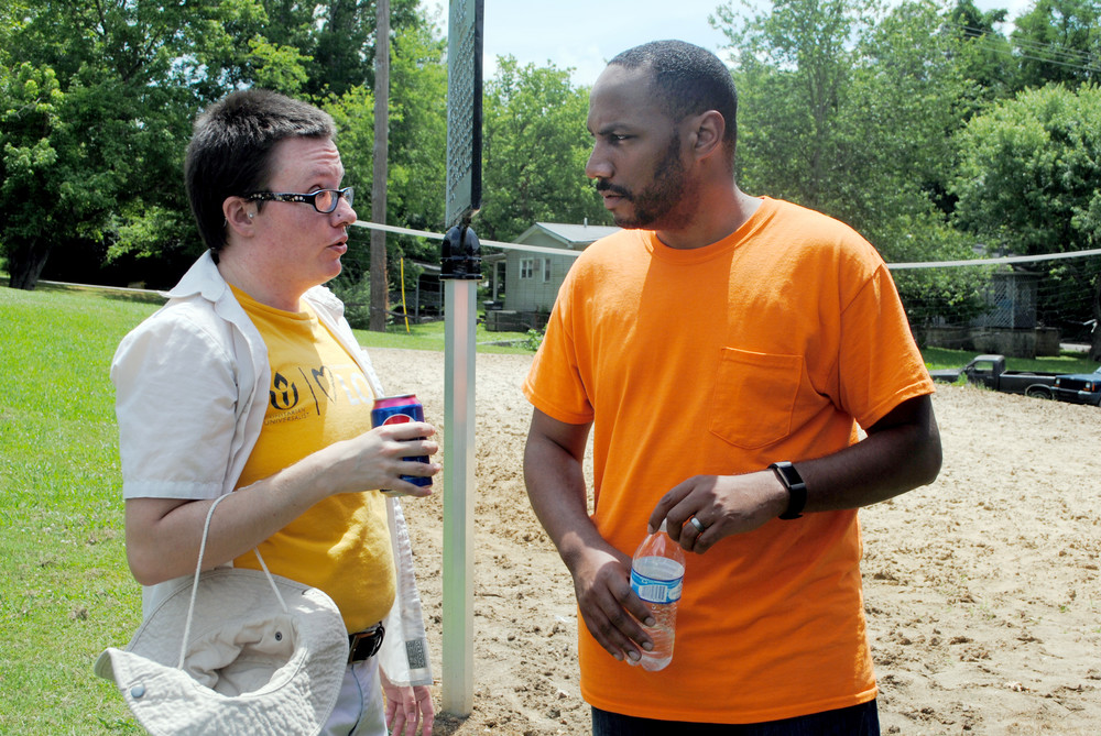 Elisha Webb of IMPACT, left, talks with Oliver Kelley of the Unitarian Universalist Church during Saturday's Juneteenth.