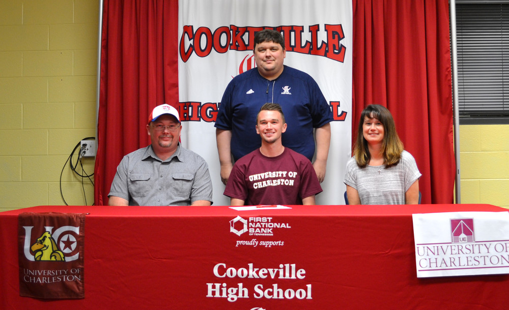 Cookeville High School graduate Bralen Clouse, front row, center, signed a national letter of intent to play soccer next season at the University of Charleston in Charleston, West Virginia during a ceremony at CHS. Clouse is joined for the event by, front row, from left: Michael Clouse, father; Bralen, Ginger Clouse, mother; back row: Clif Matlock, athletic director at Cookeville High School.