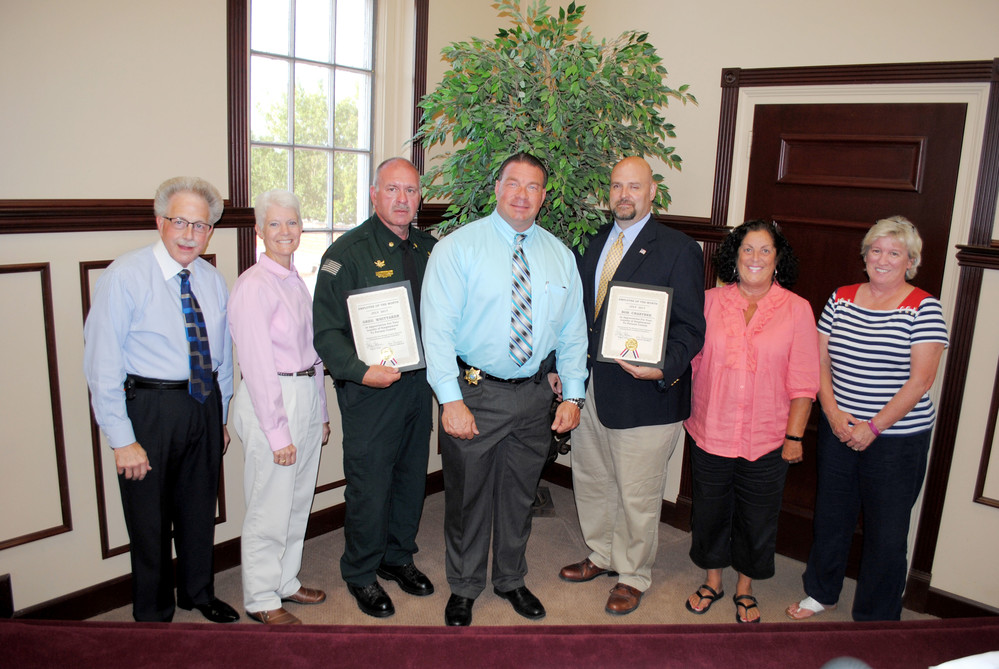 Putnam County sheriff's department employees Greg Whittaker and Bob Crabtree, who have completed training at the FBI National Academy, were recognized Monday as Employees of the Month. Pictured, from left are County Clerk Wayne Nabors, County Commissioner Cindy Adams, Whittaker, Sheriff Eddie Farris, Crabtree and County Commissioners Cathy Reel and Kim Bradford.
