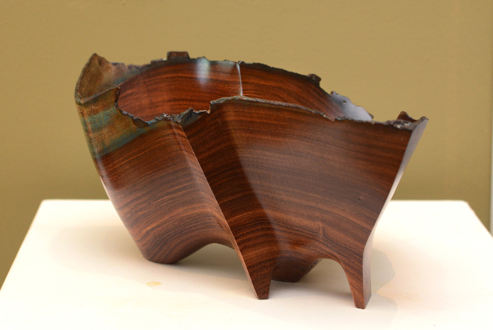 Sells' work features different aspects of wood sculptures.