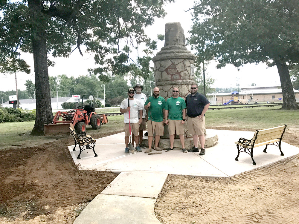 From left, Stephen Poteet, Tommy Palk, Matt Haugk, Matt Finley and John Ross Albertson of Putnam County's Parks and Recreation Department pose in front of the Standing Stone Monument in Monterey. The department has been working to improve and expand the monument park.