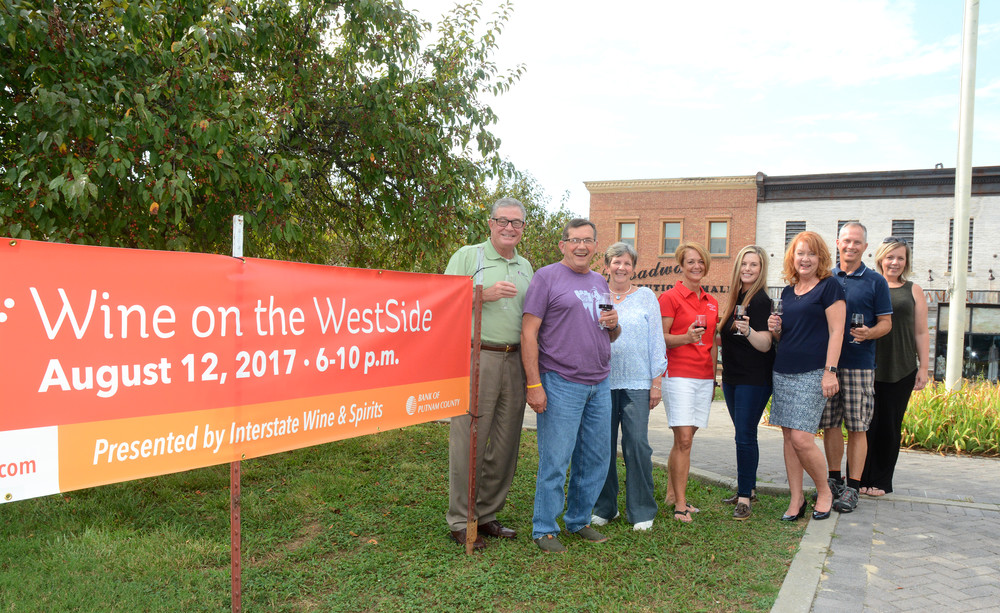 Preparing for the upcoming Wine on the Westisde, from left, are John Story, Bank of Putnam County; Allan Stingley, Wine on the Westside; Debbie George, Carrie Limbacher and Katherine Reid, Interstate Wine and Spirits; Billie Stingley, Wine on the Westside; Keith Lilly, Rail Trail authority board member; and Melissa Garrett, Genesis House director.