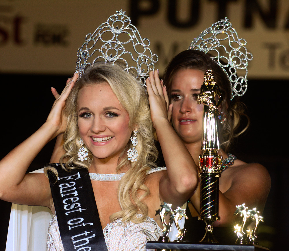 The 2017 Putnam County Fairest of the Fair, 17-year-old Abigail Dalton of Cookeville, daughter of Randy and Susan Dalton, is crowned at the pageant Thursday night by last year's queen, Carly Stout.