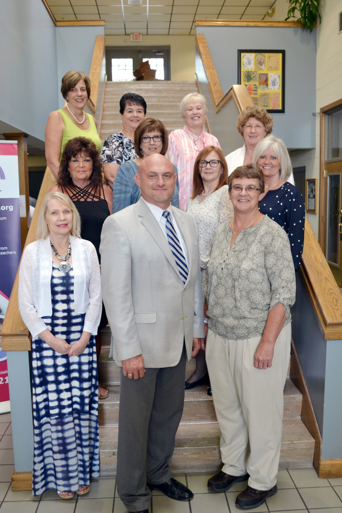 The Putnam County School Board held a reception this month to recognize teachers who retired from the school system this year. Pictured, back row from left, are Jean Webb, Diane Wheeler, Vickie Matheny and Linda Nash; middle row, Theresa Thomas, Cindy Garrett, Ginny Poteet and Tish Garrett; front row, Cindy Garrett, Director of Schools Jerry Boyd and assistant director Denette Kolbe.