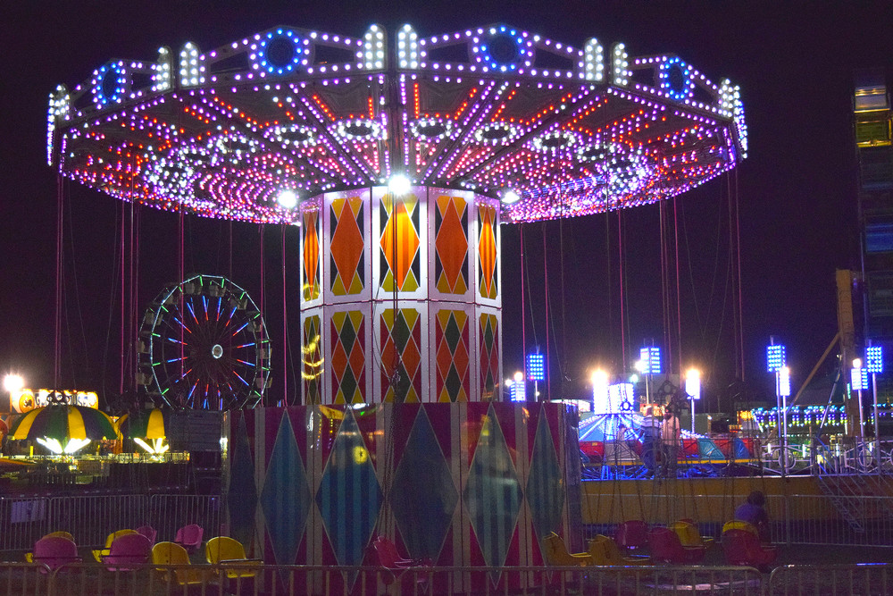 Despite rainy weather that delayed events Monday, the colorful lights of the fair look just as pretty.