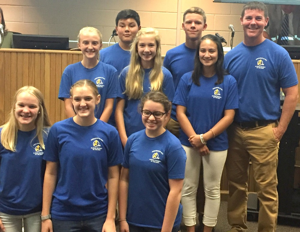 Members of the Algood Middle School Odyssey of the Mind team were recognized at this month's school board meeting for finishing fifth at the world finals. Pictured are, front row from left, Hannah Smith, Abby Fox and Aasta Thurman; second row: Claire Hill, Sarah Bastian and assistant coach Sophie Rooney; third row: Jack Henry, Caden Jones and coach Justin Brown